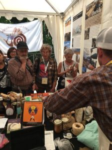 At the Turtle Island Booth, Dan C. sharing Indigenous foods from the US with people from all over the world.